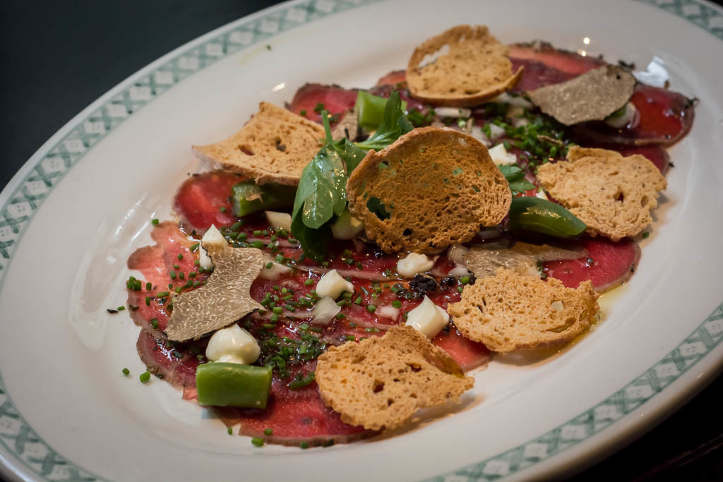 Alchemy Concept Restaurant - Venison carpaccio with shaved truffles and truffle oil
